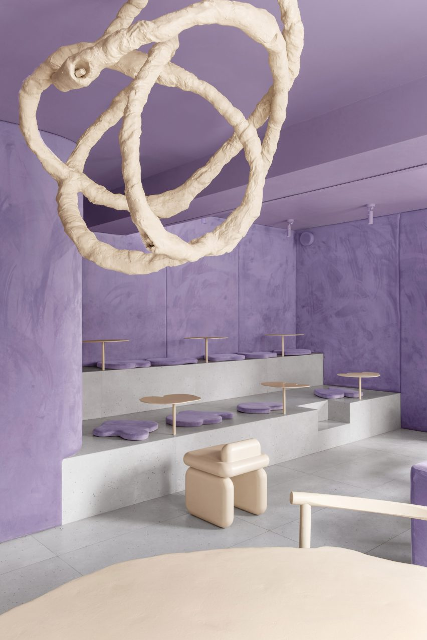 Chandelier and velvet walls in doughnut-themed cafe in Russia