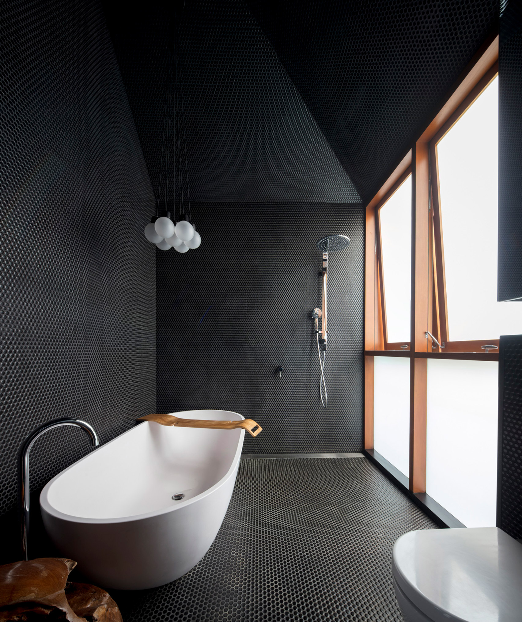 black tiled bathroom in Screen House by Carter Williamson Architects