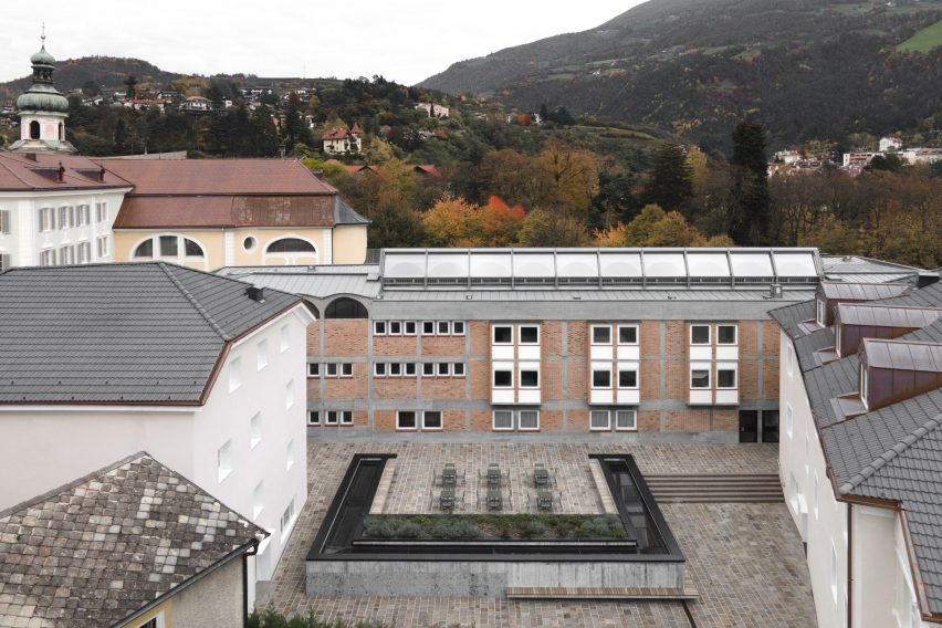 Plaza above new conference hall at Cusanus Academy renovation by MoDus Architects