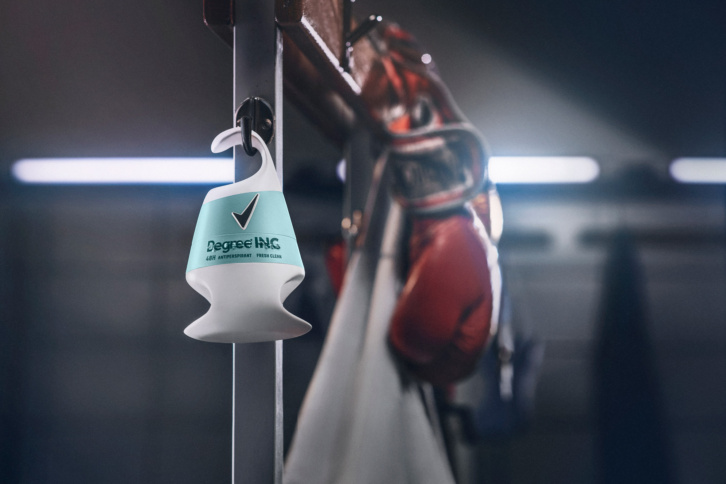 Deodorant packaging for people with disabilities by Unilever on a changing room hook