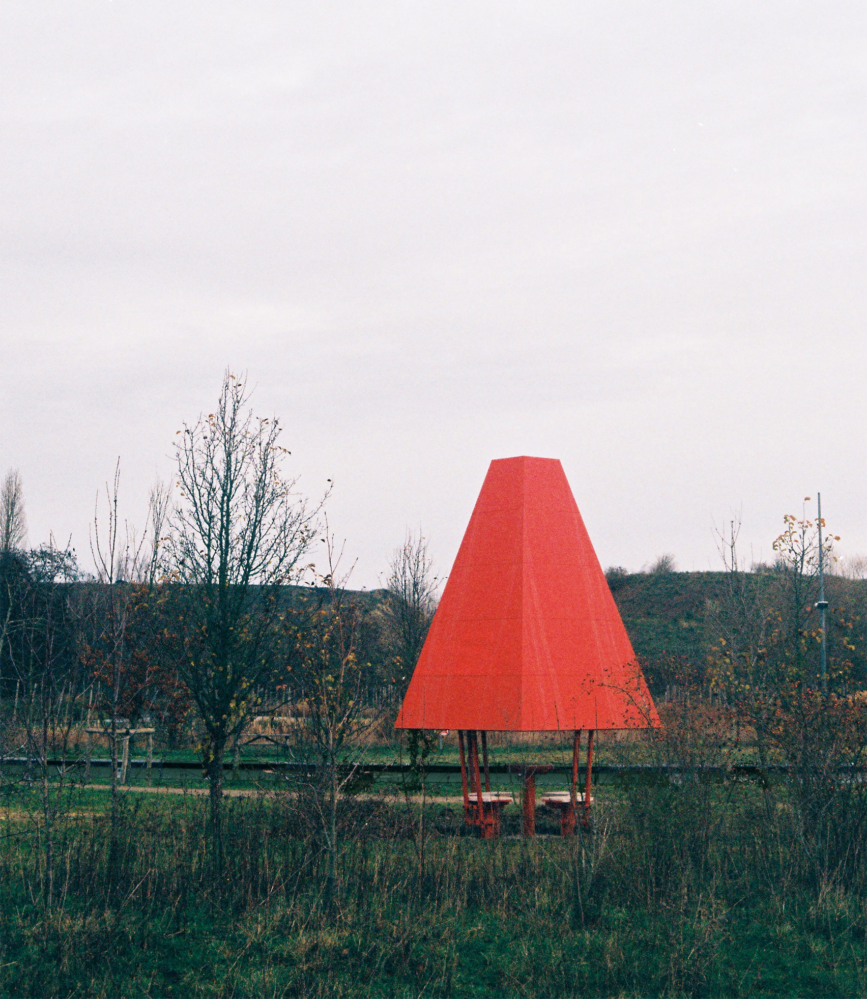 A park with a bright red chess pavilion