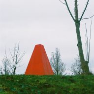 Red steel distinguishes tiny chess pavilion within French parkland