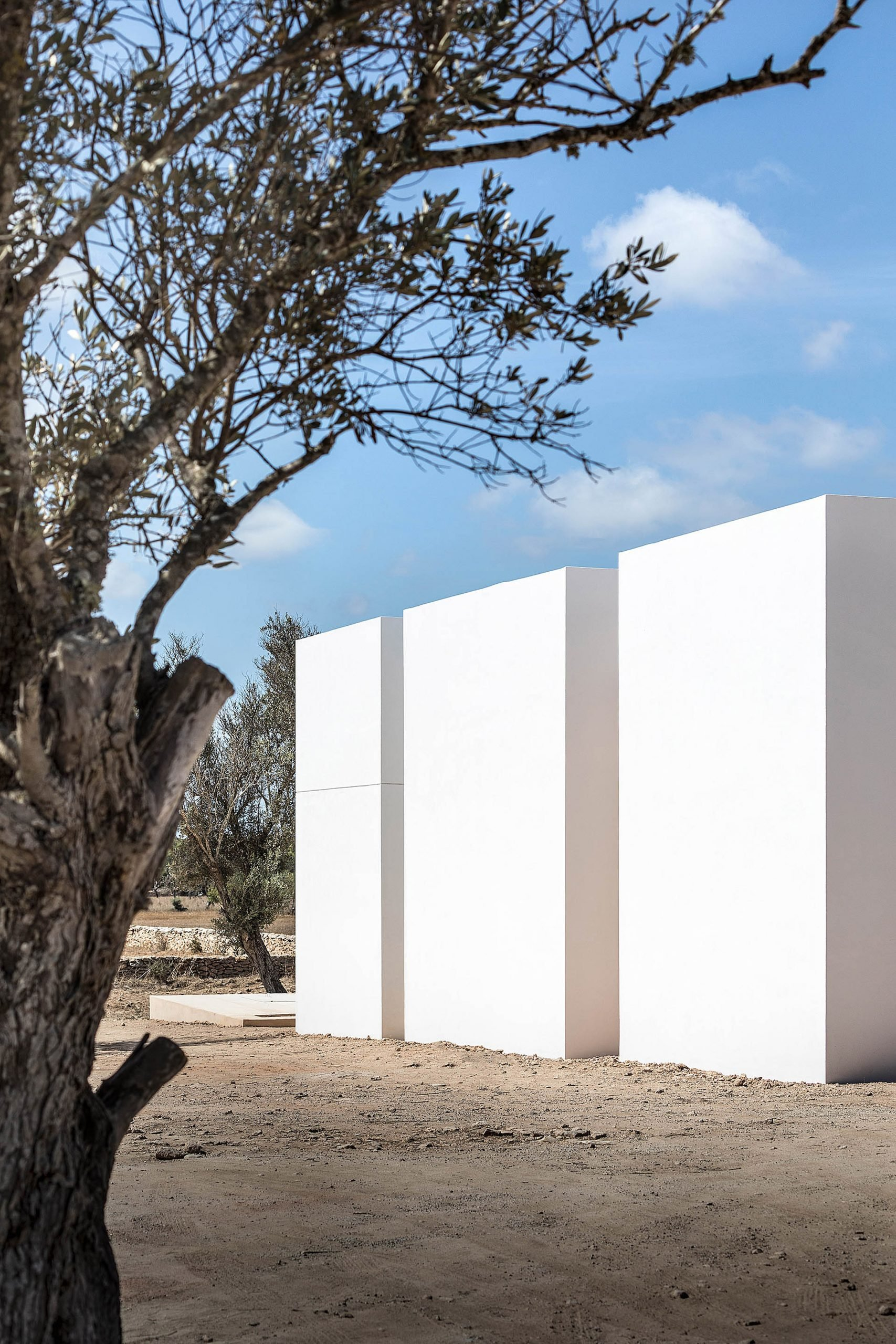 Three white volumes form the home by Maria Castello