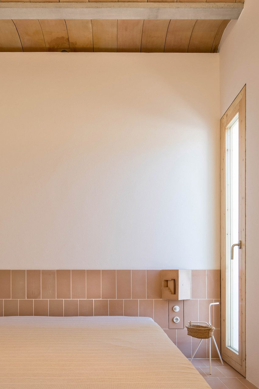 The bedroom has a tiled baseboard by Maria Castello
