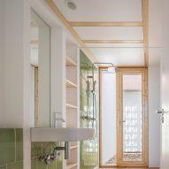 It has a green tiled bathroom