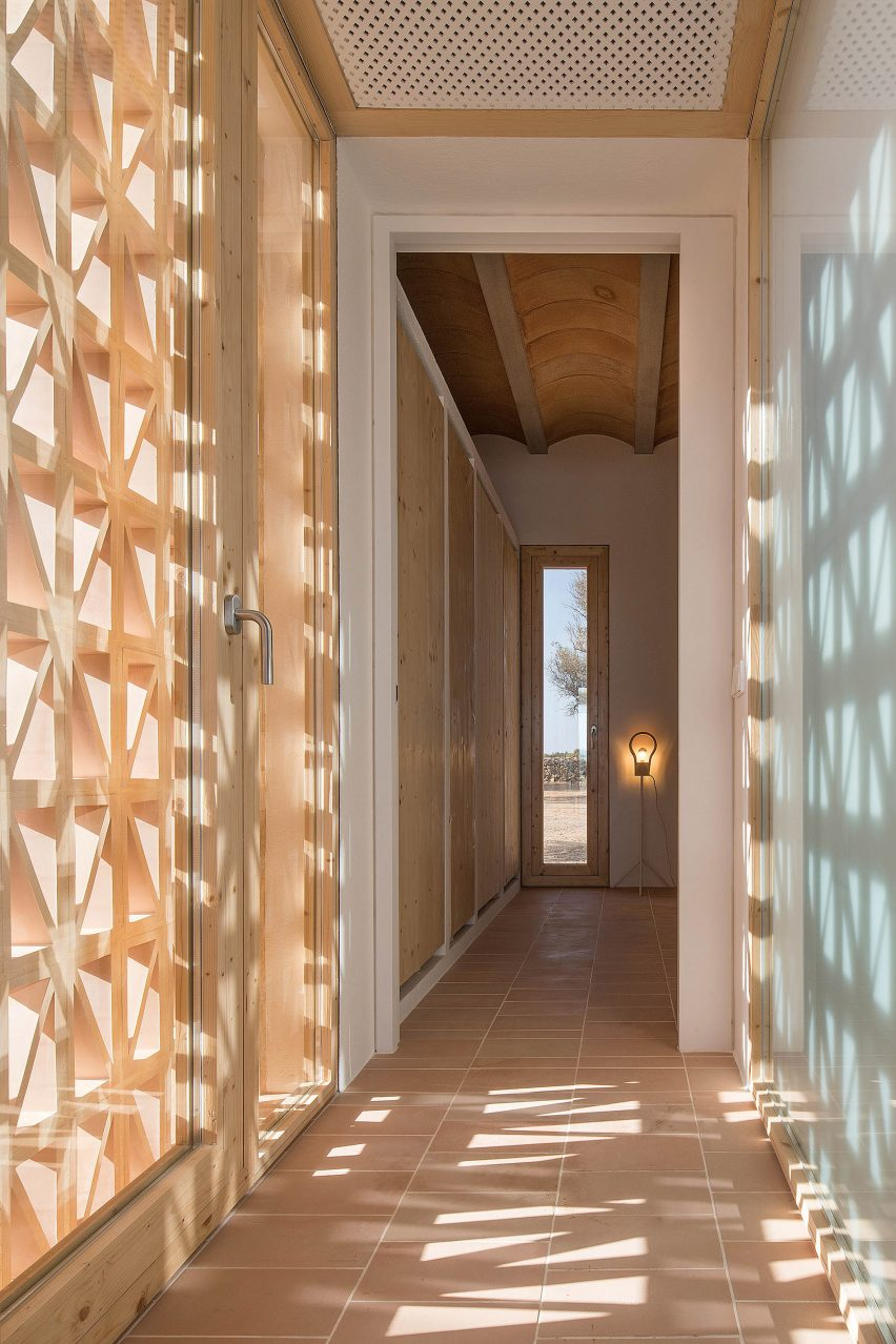 Pale wood was used for door frames and windows by Maria Castello