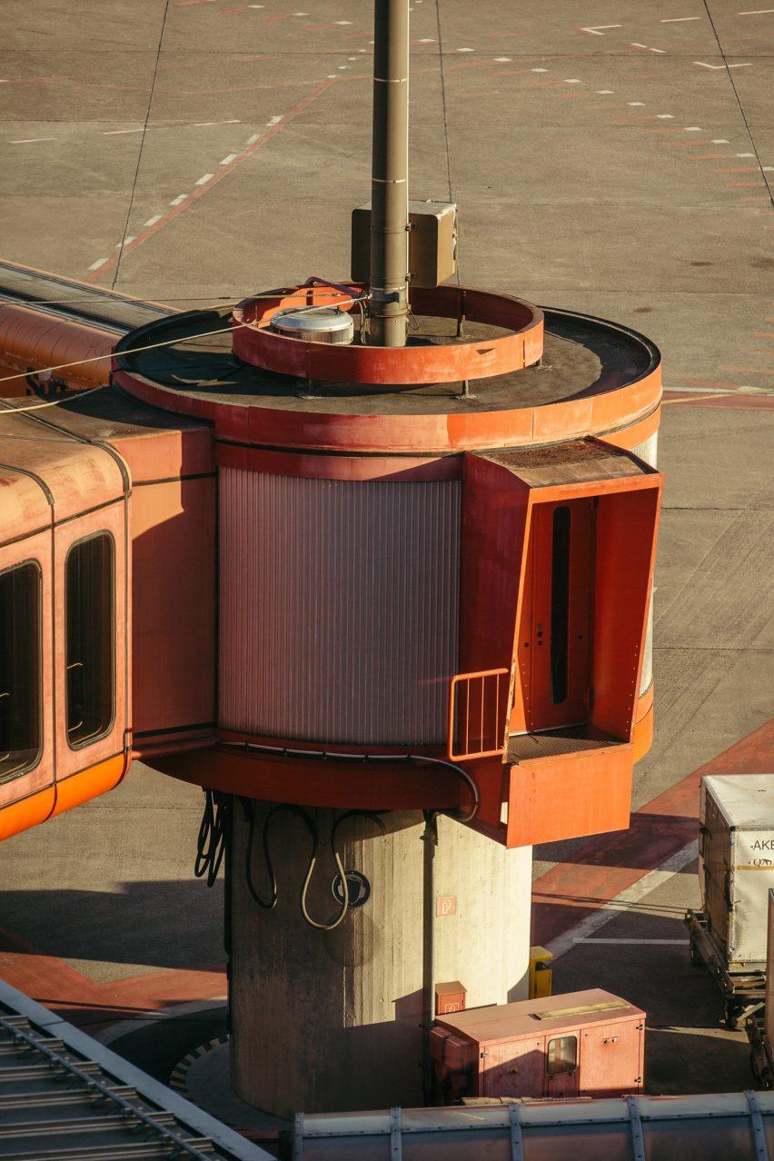 Red boarding bridge photographed by Robert Rieger and Felix Brüggemann