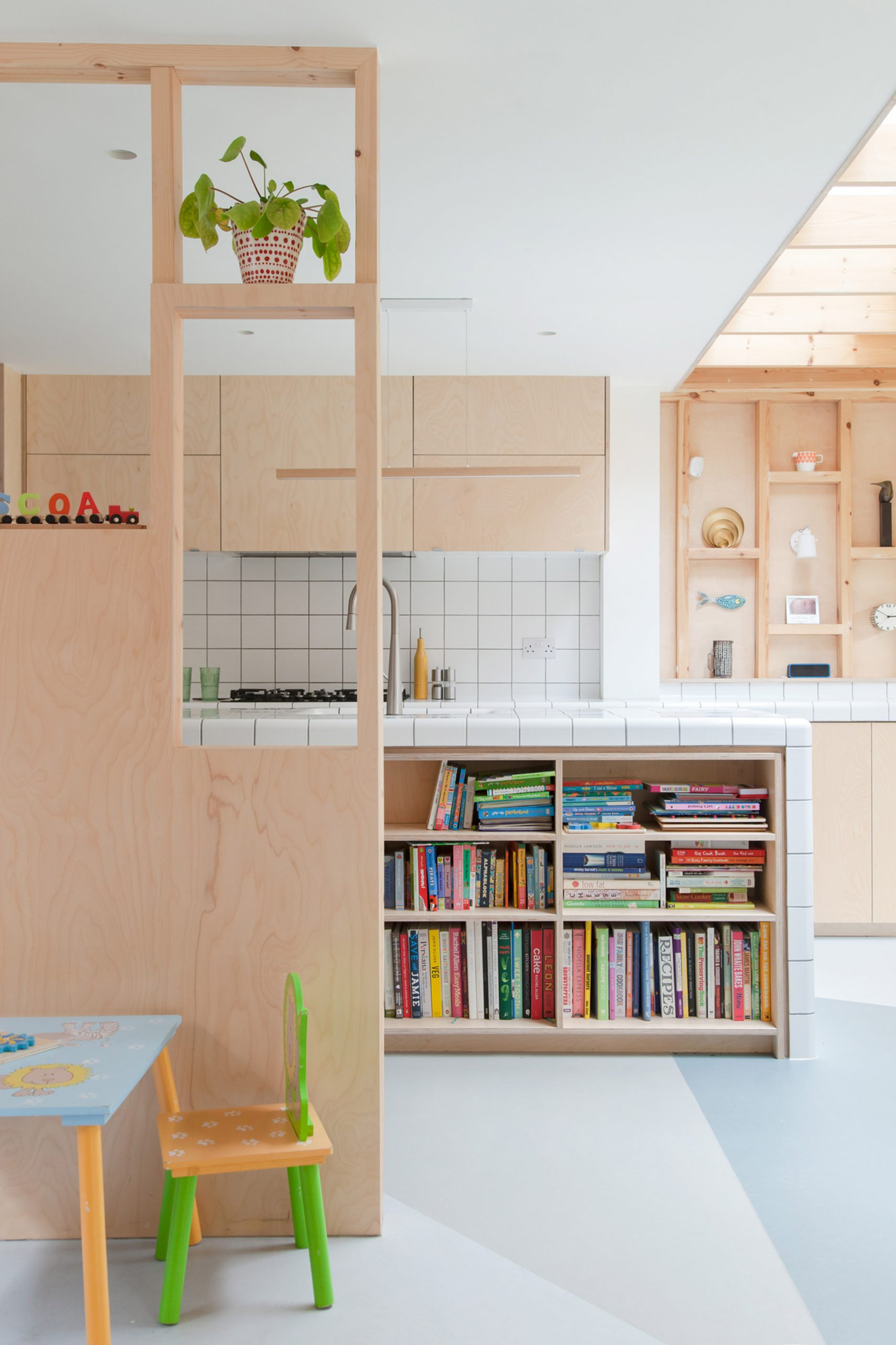 A kitchen with timber walls and cabinets