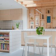 A kitchen with wooden walls and cabinets