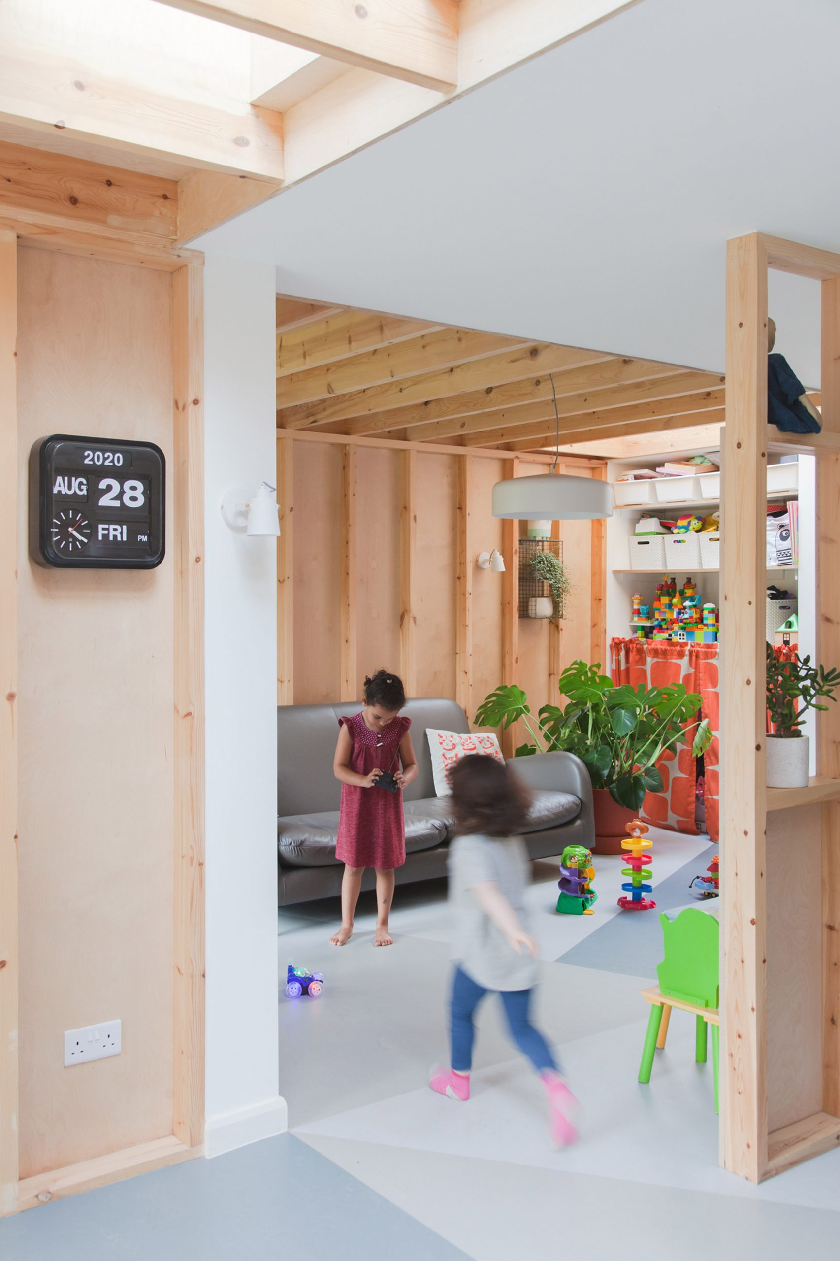 A wood-lined living room and playroom