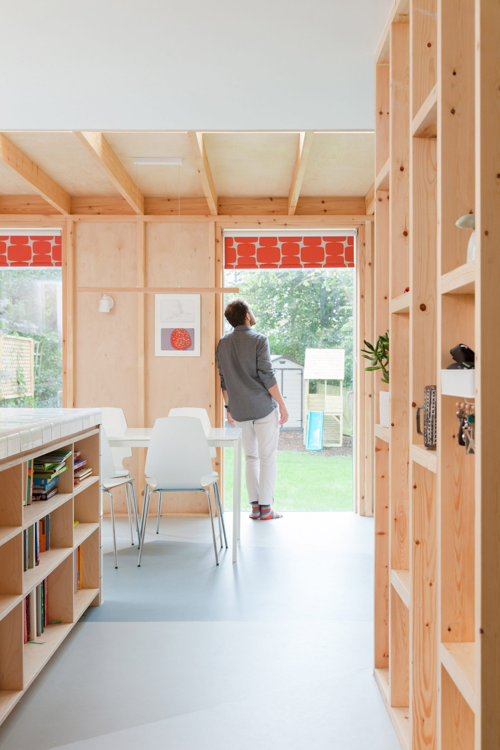A kitchen with an exposed wooden structure