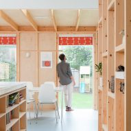 Wooden partitions add flexibility to Fruit Box house extension in London