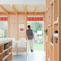 A kitchen with a wooden structure