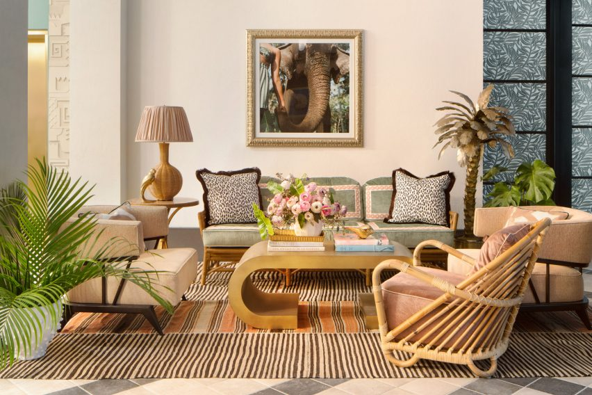 Lounge of Miami hotel with rattan furniture and leopard print pillows designed by Ken Fulk for Pharrell Williams and David Grutman