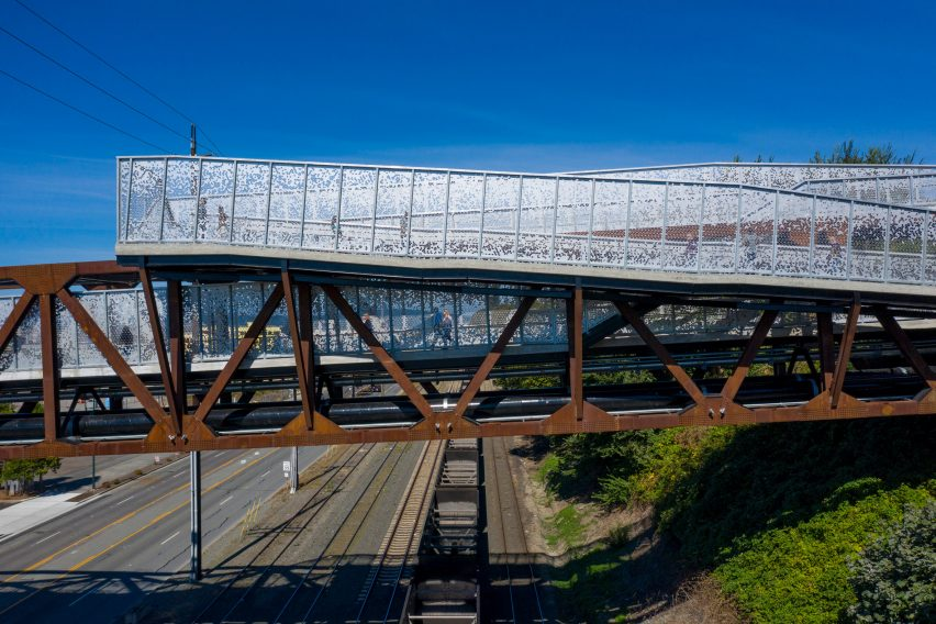 Weathering steel trusses and perforated steel guardrails of a bridge