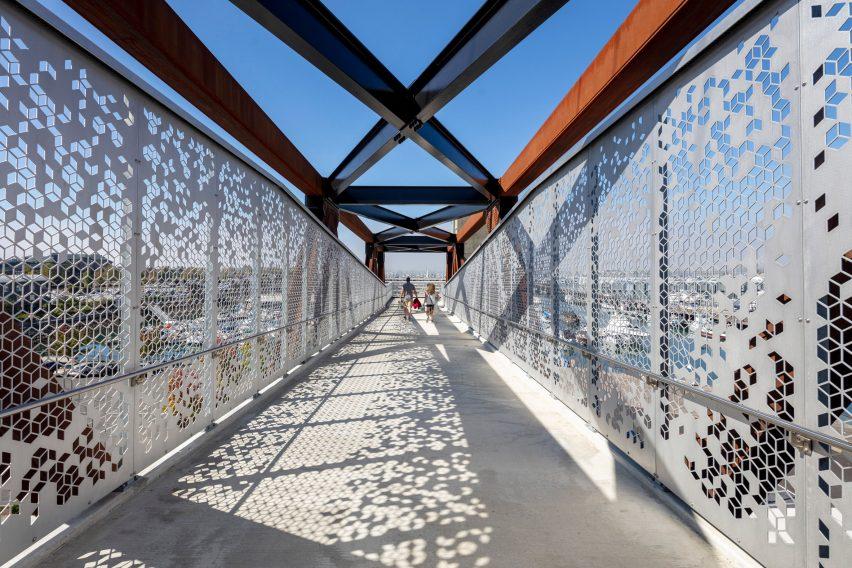 CNC Waterject cut geometric patterns on steel panel guardrails