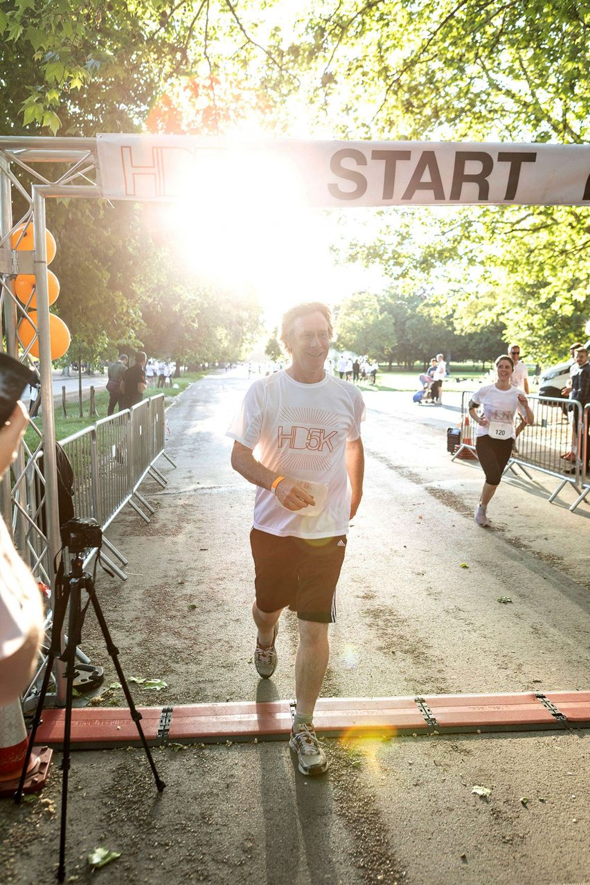 Ivan Harbour crosses the finish line at the HD5K 2019 run