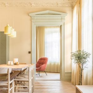 Pale yellow dining room with wooden floors