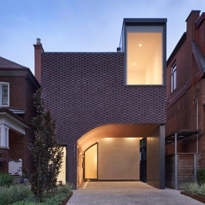 Vaulted tunnel runs through brick house by Batay-Csorba Architects