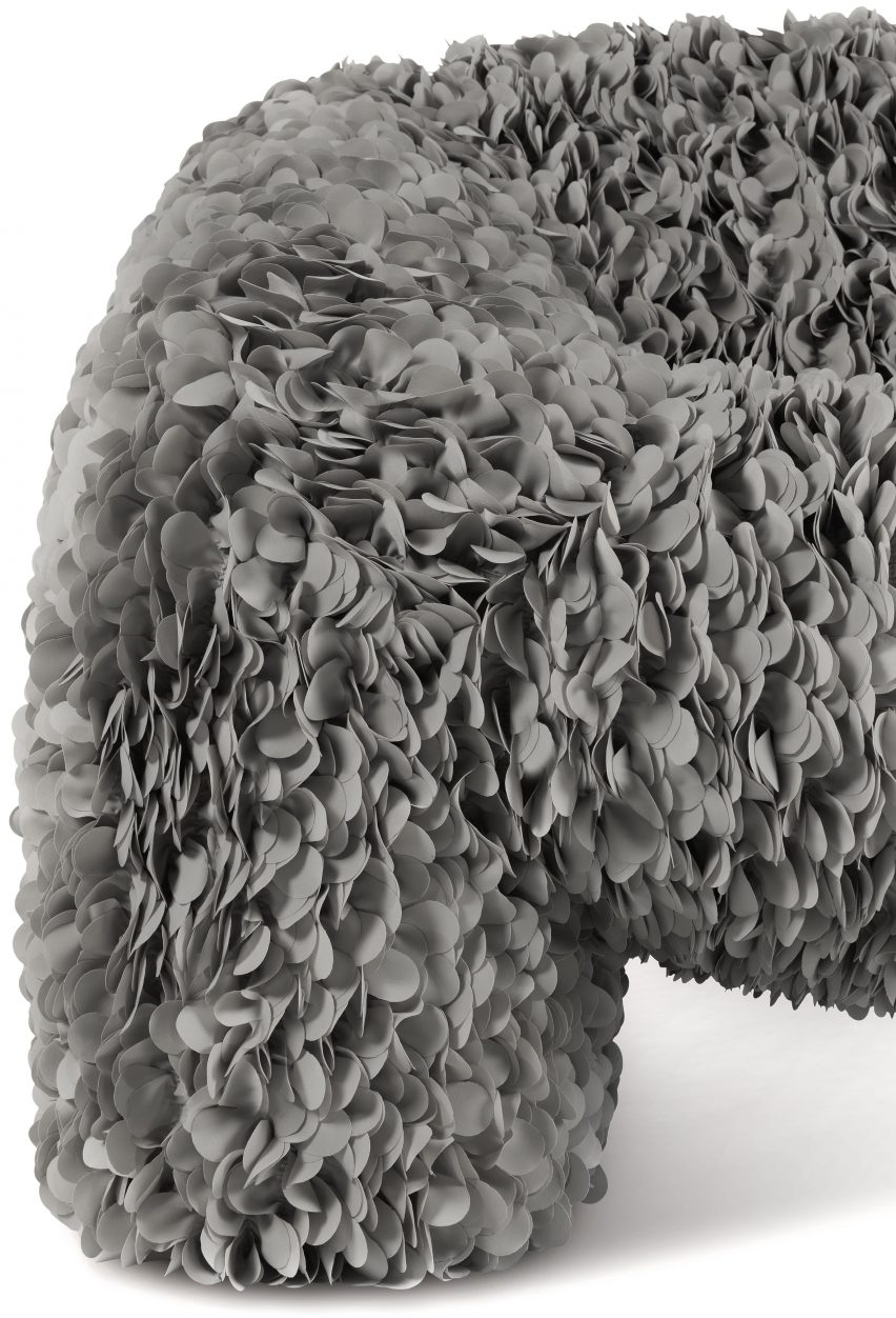 Close-up of grey petals on chair designed by Andrés Reisinger and Júlia Esqué for MoooiModules of 40 petals are sewn onto a backing textile