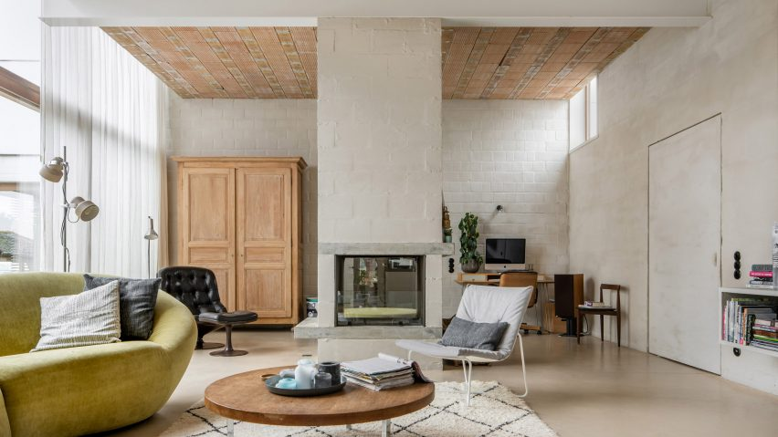 A living room with roughly plastered walls