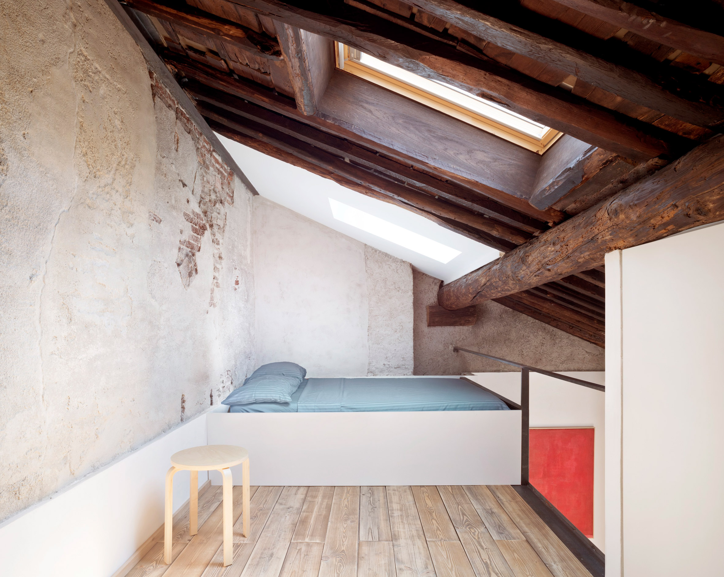 A bed deck in a loft apartment by Dodi Moss
