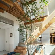 An atrium and staircase in a Japanese house