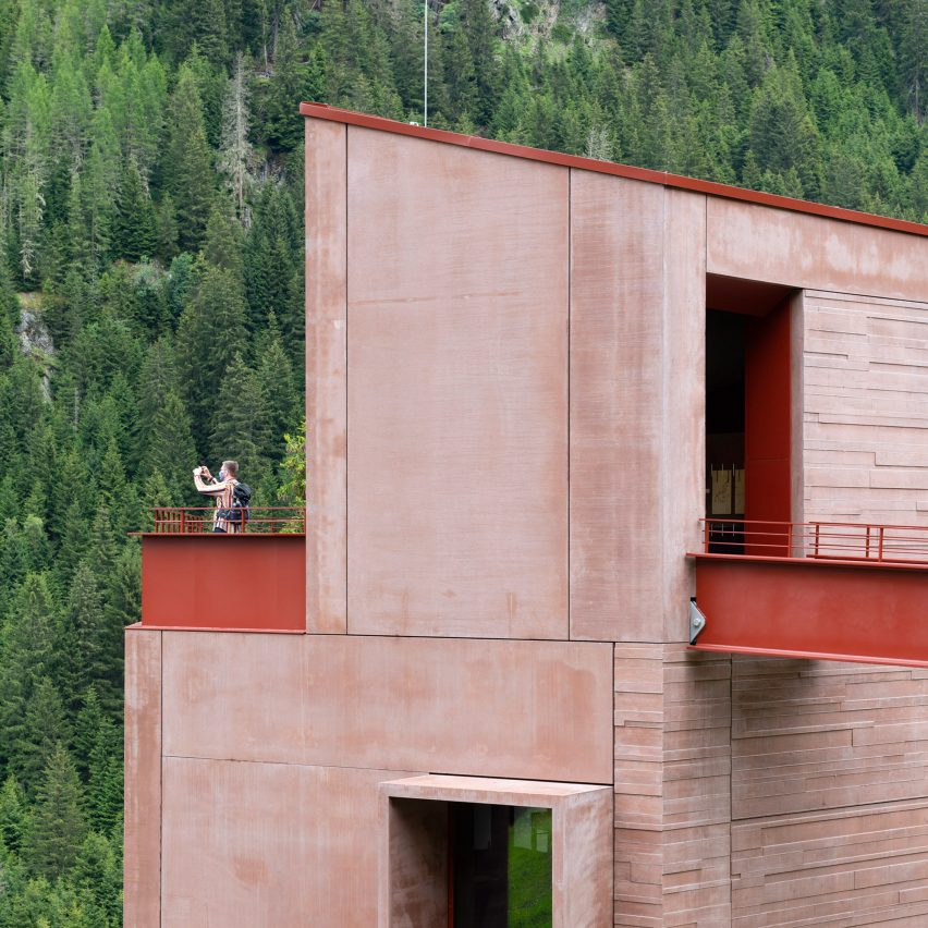 Red concrete exterior of Ibex Museum St Leonhard by Daniela Kröss and Rainer Köberl