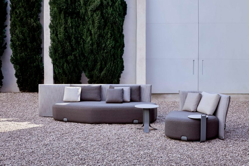 There is a grey upholstered outdoor seating by Gan