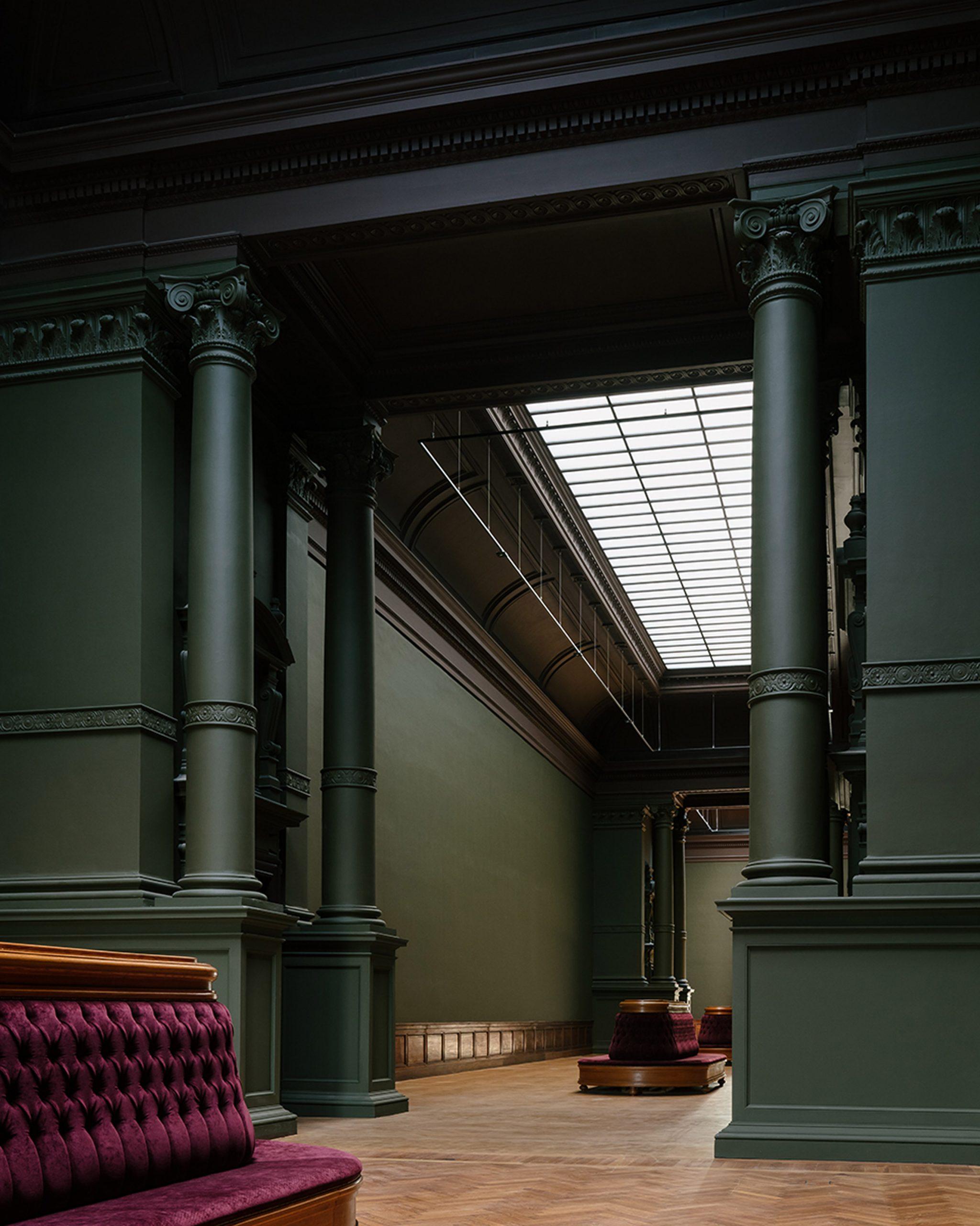 Dark green walls in neoclassical exhibition halls restored by Kaan Architecten