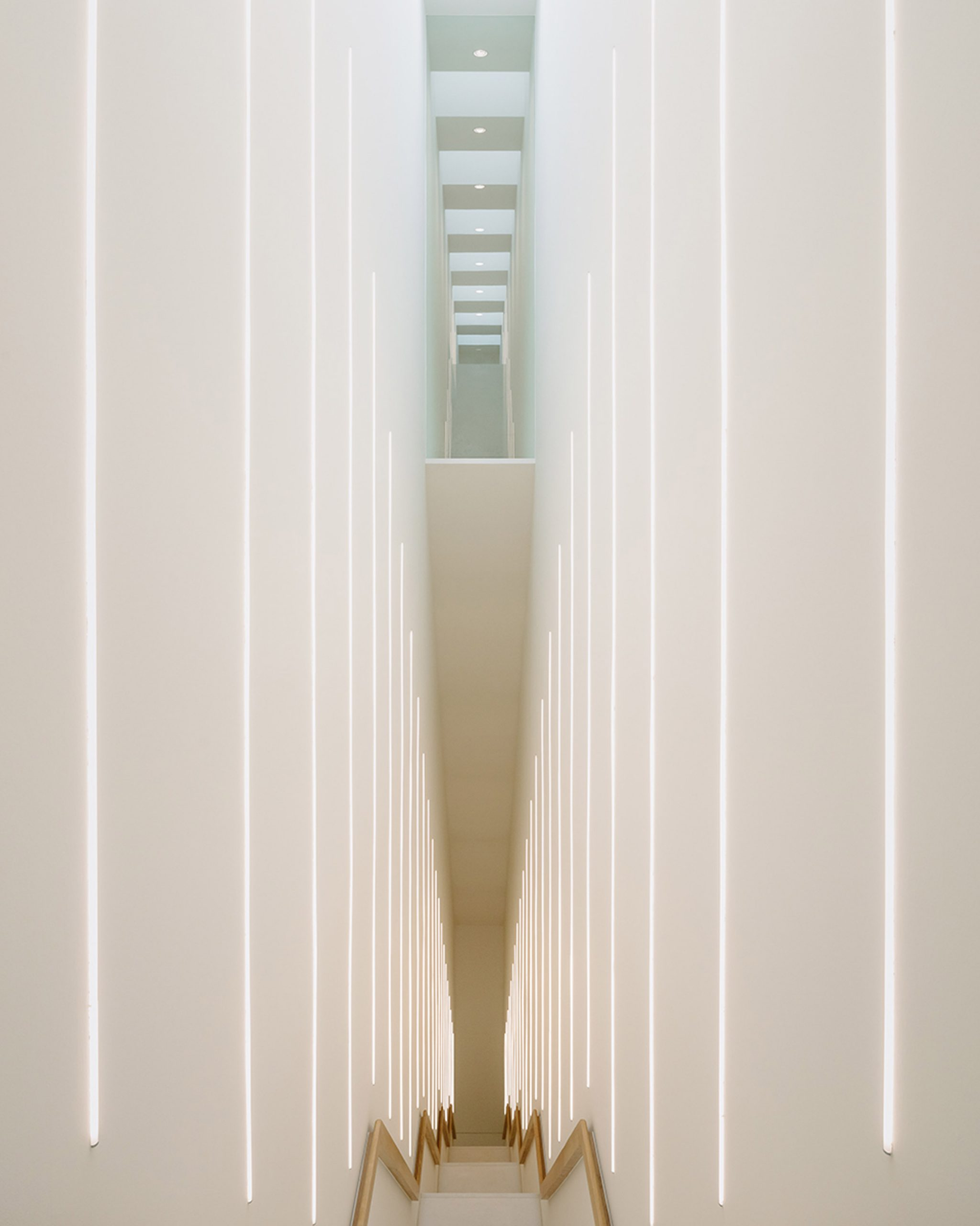 Tall stairwell with LEG lights in museum extension by Kaan Architecten