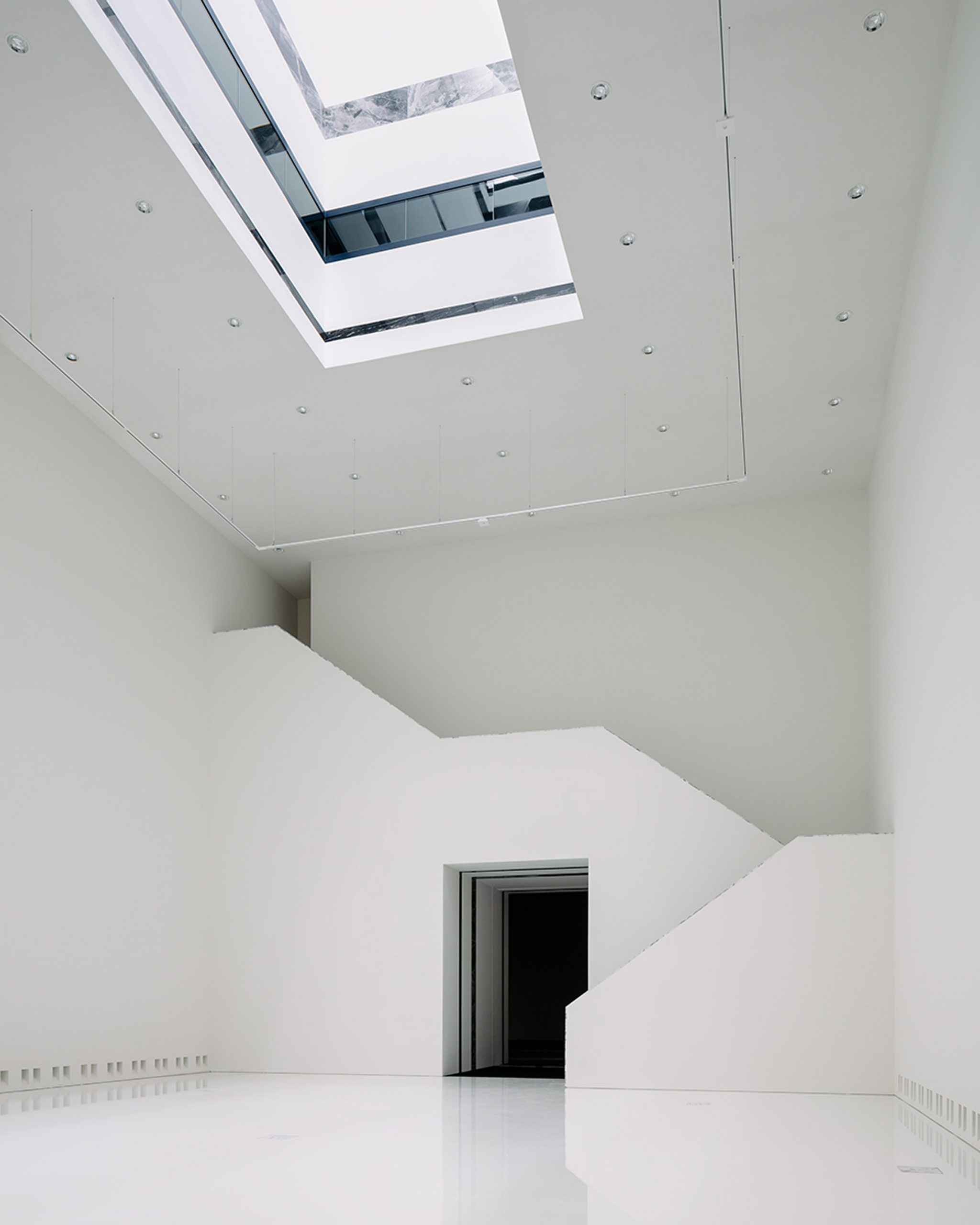 Modern museum extension with light well by Kaan Architecten