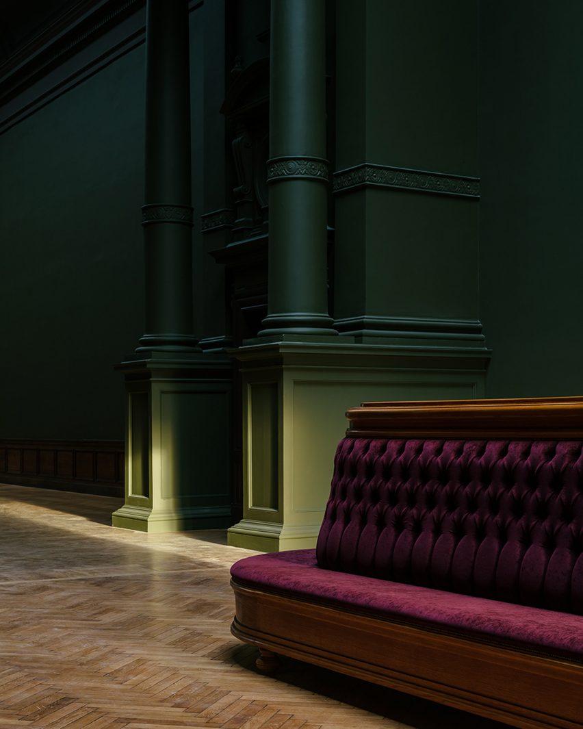 Red sofa and green walls