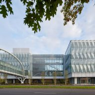 Triangular glass panels wrap Knight Center at the University of Oregon