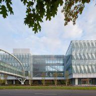 Triangular glass panels wrap Knight Center at the University of Oregon