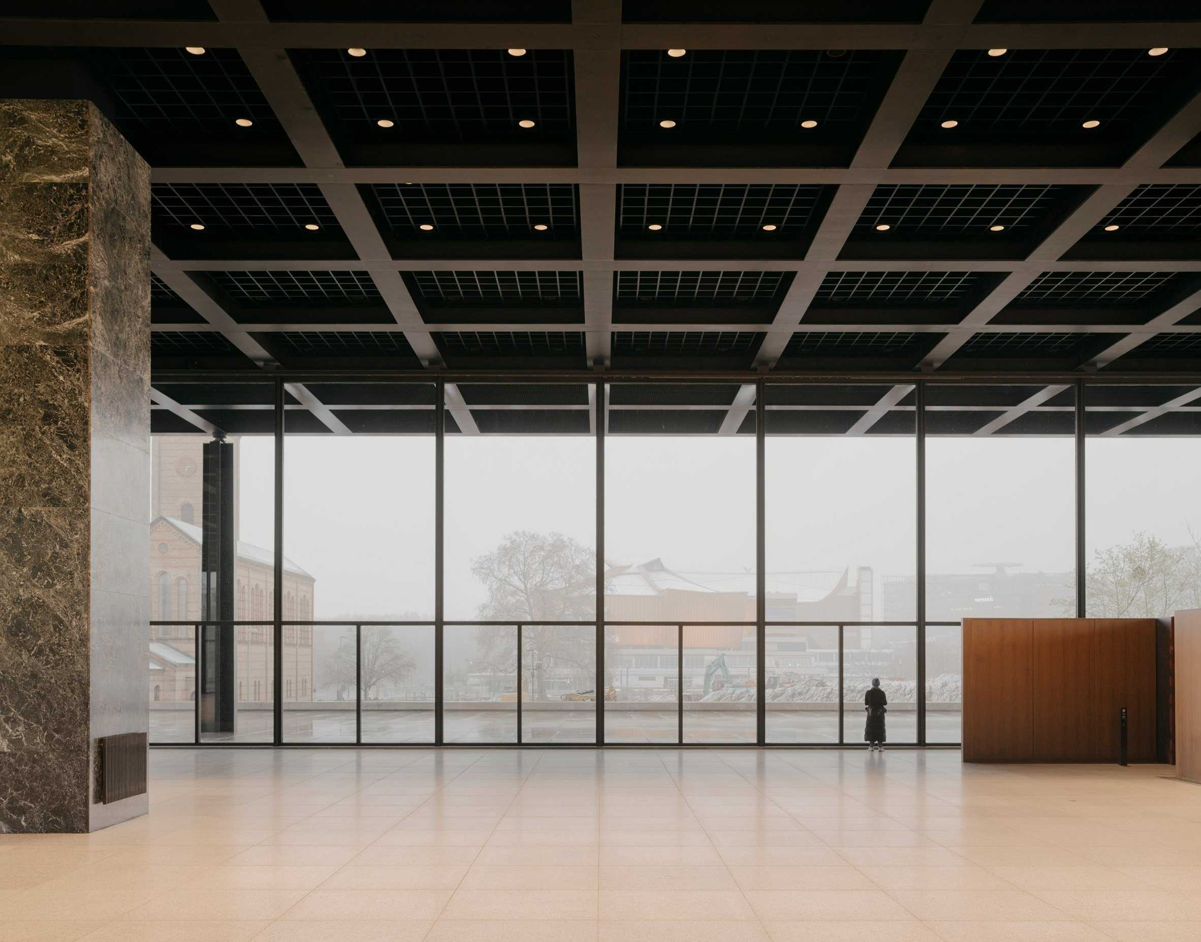 The interiors of a museum by Mies van der Rohe