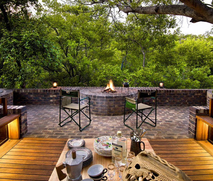 Outdoor fire place in jungle home