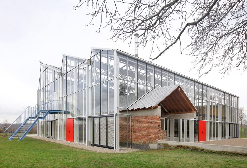 A greenhouse containing old agricultural buildings