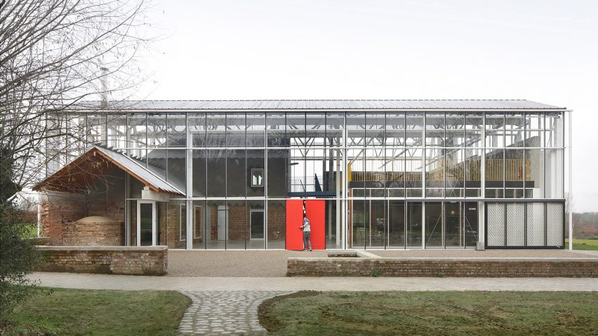A greenhouse-like structure containing agricultural buildings