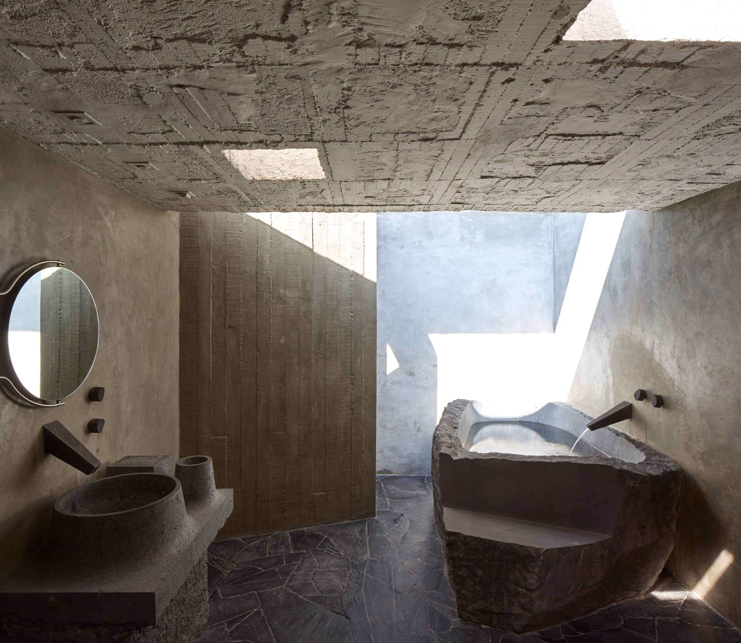concrete bathroom in Reyes House by Pedro Reyes and Carla Fernandez