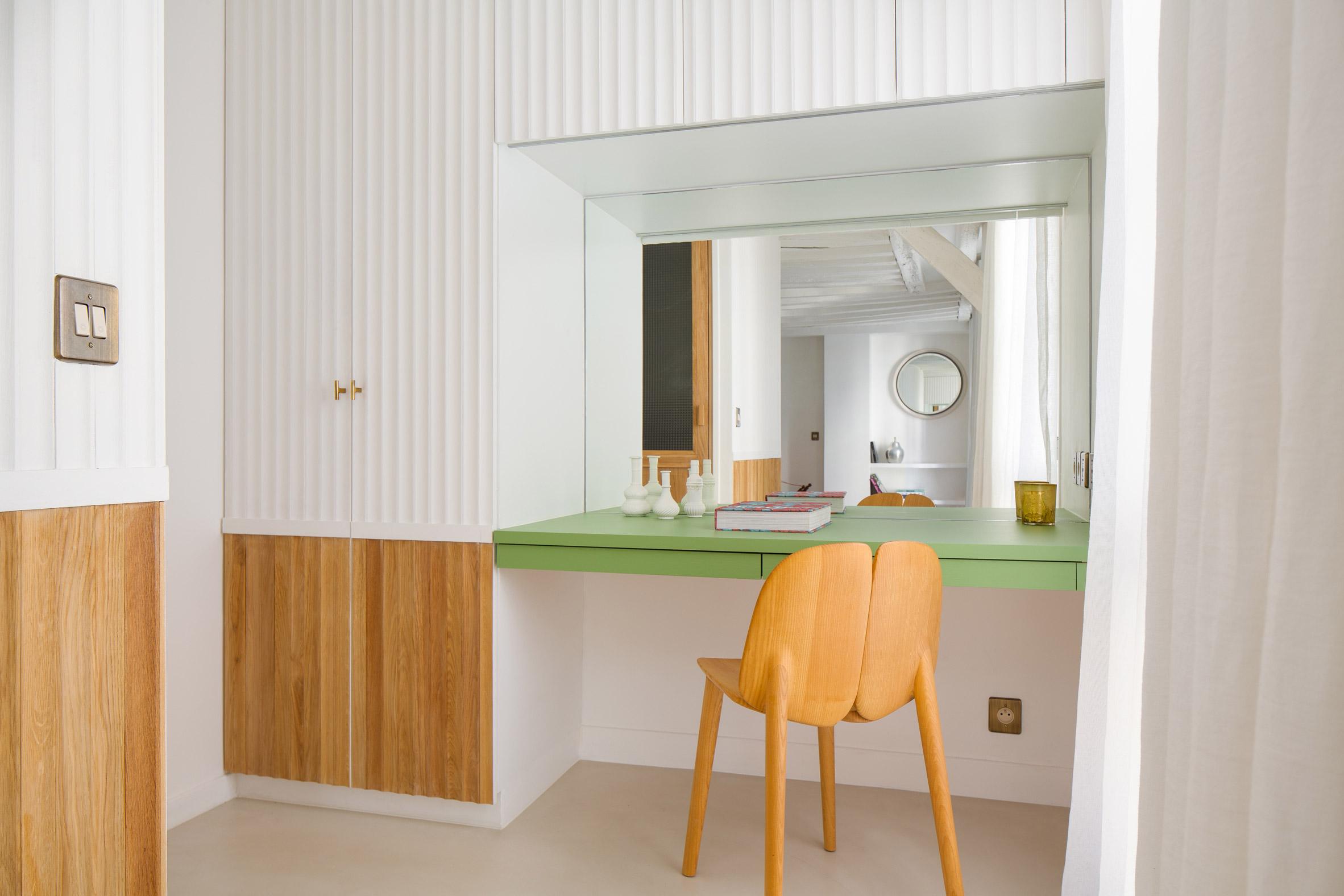 A dresser is built into the wall by Pierre-Louis Gerlier Architecte