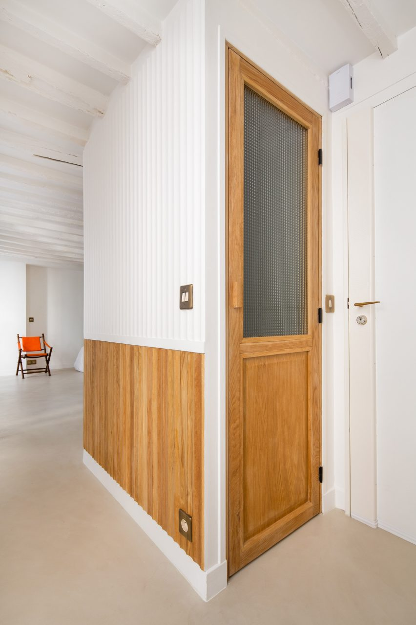 Doors have a stained wood and frosted glass construction