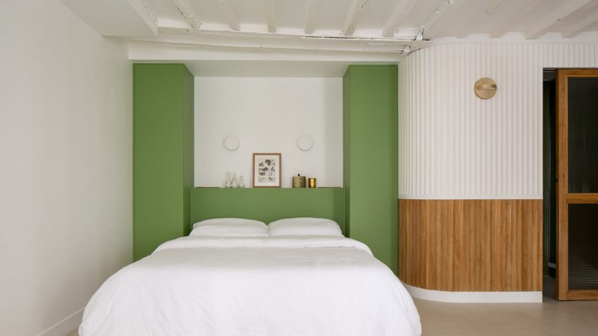 Green walls frame the bed space