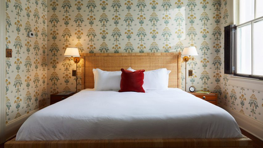 Post House Inn bedroom with printed wallpaper