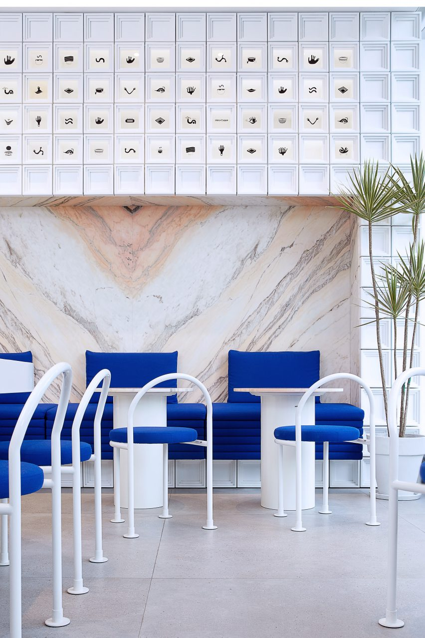 Marble panelling and white MDF blocks in seating area of Mini Cuppa cafe