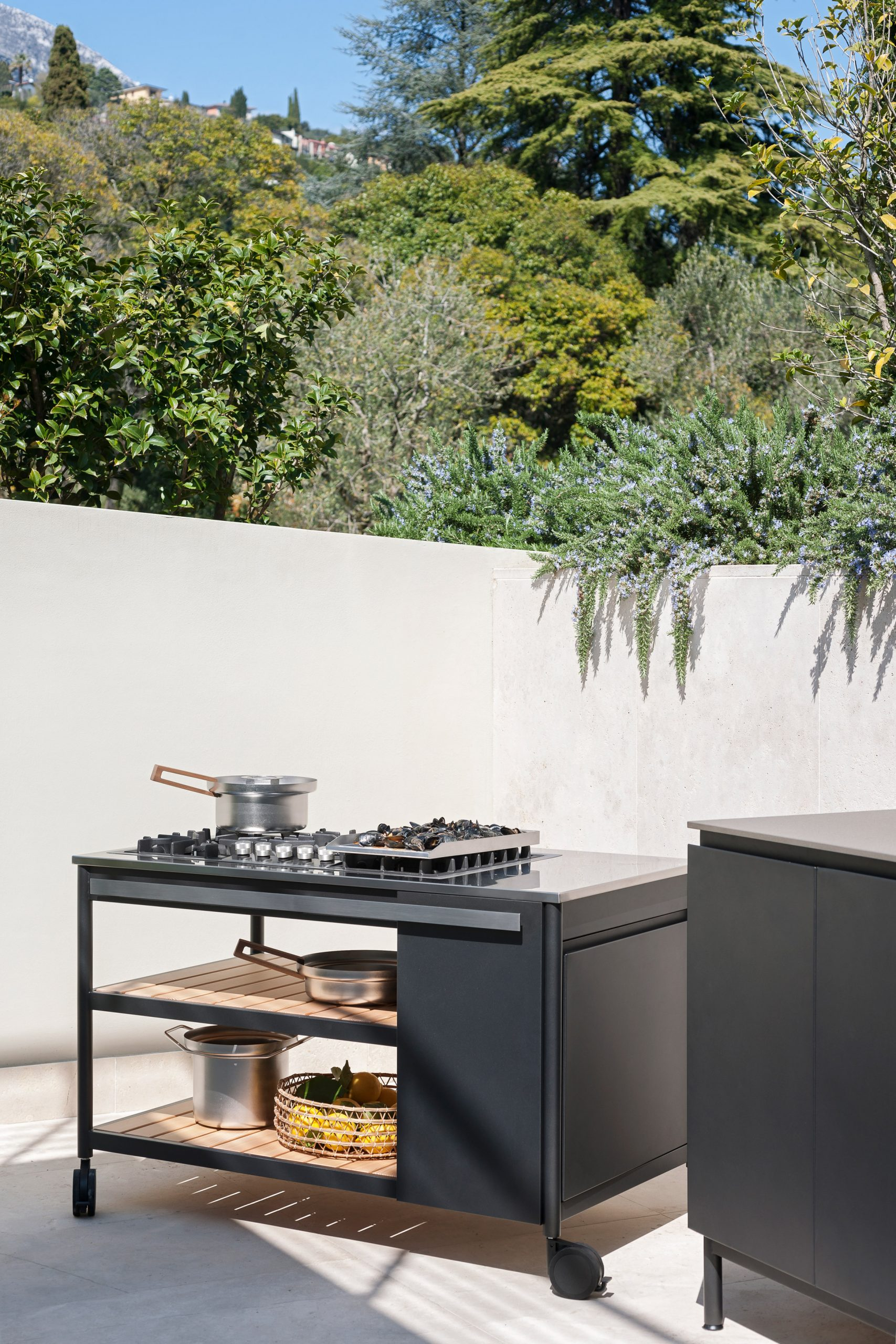 Outdoor cooking module by Roda with a five-top stove