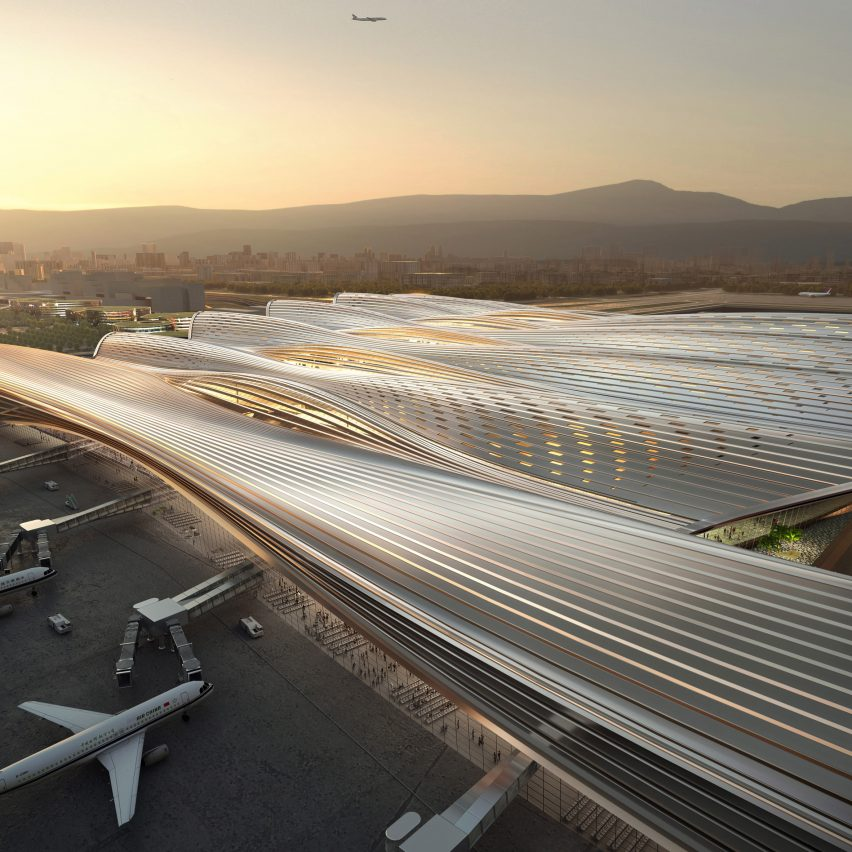 The terminal has a sweeping roof by Rogers Stirk Harbour + Partners
