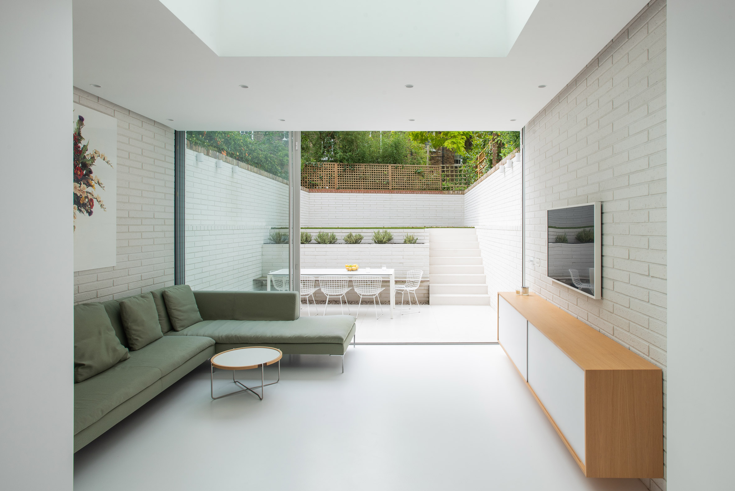View from the interior out to the sunken garden by Moxon Architects