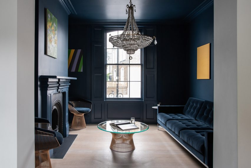 A deep blue blankets the sitting room by Moxon Architects