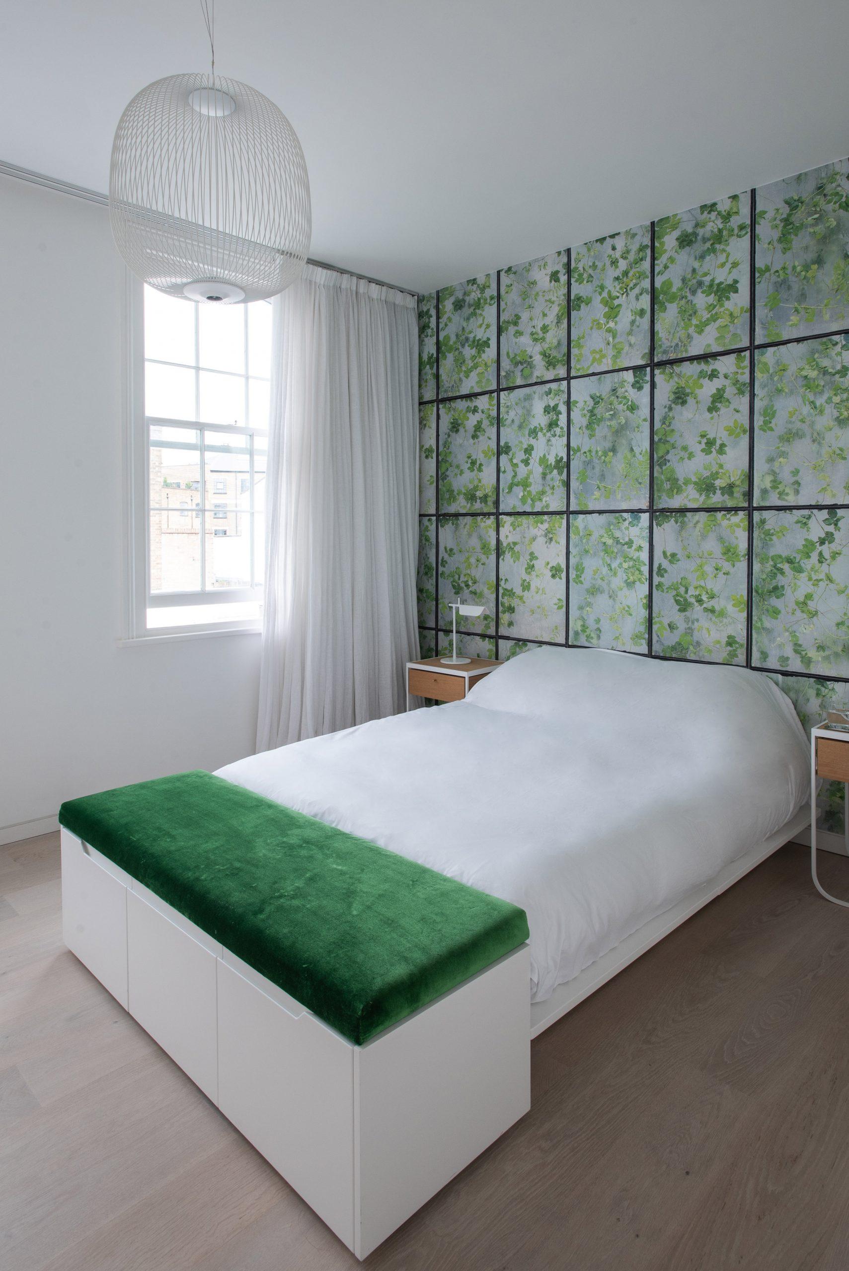 The bedroom employs a similar minimal look
